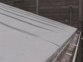 The edging is unique to he older metal panel roofs, not done today except by one manufacturer