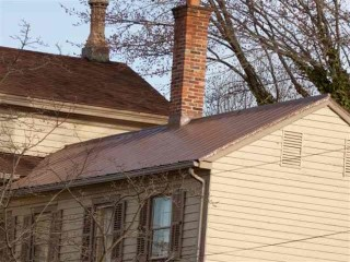 Chespeake City matching asphalt shingle roof and metal panel addition