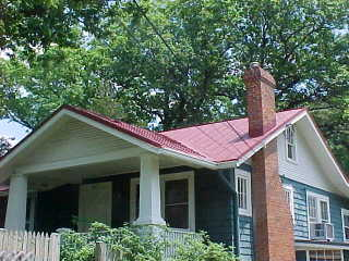 After photo of cottage in Washington DC where sealer in traditional red has been applied by Roof Menders' crew