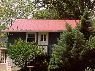 Back of cottage with tin roof sealer