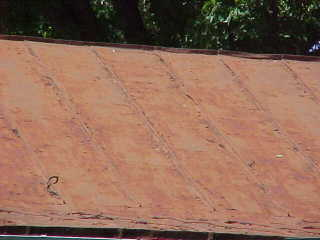 Roofing panels before application of sealer for tin roofs